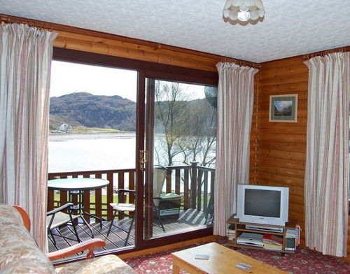 The chalet - Living room - looking out over Kirkaig  Bay.